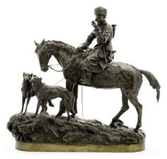 A Bronze Group of a Cossack Hunter with Two Borzoi