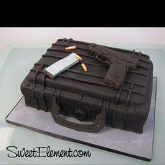 Groom's cake. J & his guns:)
