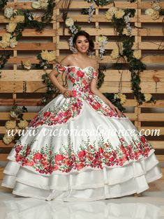 Mikado Charro dress w/embroidered appliques throughout the bodice & skirt of the dress; lace-up back, short cape included