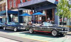 Mustangs in Black 1966 and 1967 GT Convertible Ford Mustangs at Bon Ap in Fitzroy, Melbourne.