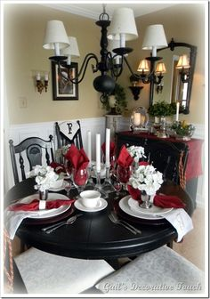 Revamp an old or out of date table and chairs by simply spray painting them black.  Love the pop of red!