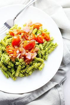 this Healthy Pesto Pasta is Vegan and Gluten Free! healthy and super simple to make! topped with sauteed tomatoes and onions! / TwoRaspberries.com