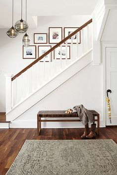 Interior Design Stories: Modern Entryway Furniture / Entry way inspiration / photo wall / photo gallery wall