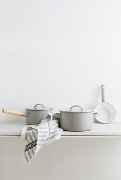 pretty grey saucepans with wooden handles
