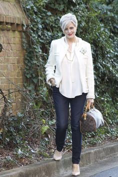 style formula - skinny jeans, silk blouse, fringed jacket, double strand pearls, brooch, heels