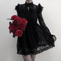 Modern vampire vibes with the enchanted 'Liliana' maiden dress in a luxe Victorian style lace, fully lined with a high neckline, ruffle detail, detachable hardware cross and long delicate bell sleeves all finished with lace trimmed hems and satin bow f Alternative Outfits, Alternative Fashion, Moda Lolita, Mode Emo, Baggy Pants, Goth Dress, Dress Lace, Lace Outfit, Batik Dress