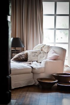 cozy corner in the living room [relaxed oversized white/cream furniture, black lampshade]