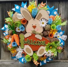 "Darling handmade Easter mesh wreath Measures approx 24"" and is very full. Wreath features a wooden bunny and lots of coordinating ribbons.    Made in a smoke free home.  Hang outdoors in a protected area. 