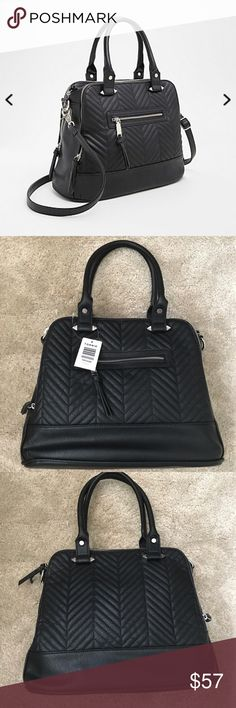 "Torrid Large Quilted Satchel Handbag NWT There's handbags you own, and then there's handbags that you carry everyday. This is the latter. The versatile black faux leather satchel style sports an eye-catching quilted front and back that turns the sophistication up way loud. The silver tone hardware lends a punkish edge along the multi zip top and removable straps. 56"" crossbody strap17"" handles14.5"" x 6.5"" x 11""Man-made material torrid Bags Shoulder Bags"