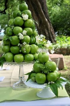 Tower of apples on a cake stand. Tip: put some sunflower oil on it to make them extra shiney #weddingplanner #AsYouDesire