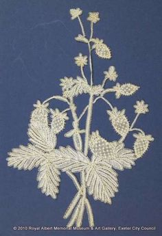 Honiton (East Devon) lace sprig - Wild strawberries represented in East Devon bobbin lace. The plant is worked with raised and rolled tap leaves and tiny flowers. The strawberries are ribbed with a purl edge. The no-pin filling has a sparsely worked background to give an open effect. This is one of a series of naturalistic sprigs (lace motifs) said to have been designed and made by Louisa Tucker, a daughter of the Branscombe lace manufacturer John Tucker. John Tucker, The Royal Collection, Wild Strawberries, Lace Embroidery, Tiny Flowers, Bobbin Lace, Lace Weddings, Artworks, Layers