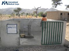 May 25: A man pumps water from a borehole in Cameroon. Photo: Adele Tabue, International Medical Corps, Cameroon 2012