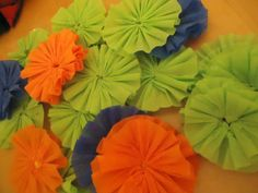 Crepe Paper Rosettes Jamie Brock Crepe paper streamers make festive party decorations but there are lots of other ways you can decorate using crepe paper. In this hub tutorial, I will show you how to turn plain crepe paper streamers into pretty. Crepe Paper Decorations, Streamer Party Decorations, Crepe Paper Crafts, Crepe Paper Streamers, Diy Paper, Paper Art, Paper Rosettes, Tissue Paper Flowers, Diy Flowers