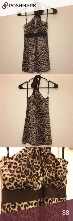 Leopard Print Halter Top Leopard print halter top. Excellent condition. Stretch lightweight jersey with a soft feel. 96% polyester, 4% rayon. Tops Tank Tops