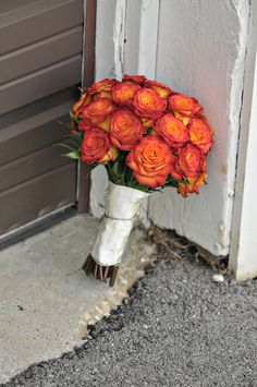 Bouquet of Circus roses. I attached my grandfather's gold necklace in remembrance of him.