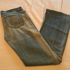 "Rock and Republic jeans Rock and republic light blue jeans.  Size 29.  I'm 5''7"" and wore them with heels so they are pretty long.  Jeans a flared on the bottom.  Excellent condition Rock & Republic Jeans Flare & Wide Leg"
