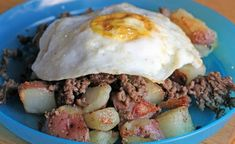 Meat & Red Potatoes Topped With Egg - I need this today! Runny yolk covering potatoes - YUM!