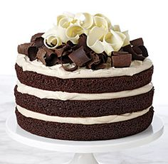 Chocolate Irish Whiskey Cake - uses whole milk, canola oil, hot coffee; frost with instant espresso, Irish whiskey (I use Maker's Mark Bourbon instead), heavy cream, dark brown sugar; chocolate curls are from semisweet and white chocolate blocks - fine cooking indeed! recipe Gale Gand