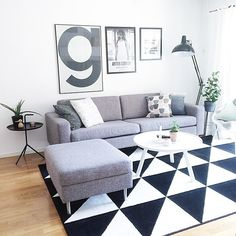 #InteriorInspiration: We love the #geometric print of this #rug contrasted with plain grey furniture.