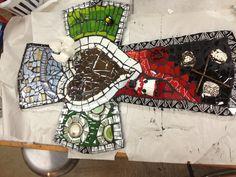 """""""Gospel without Words"""". Piqué assiette mosaic cross."""