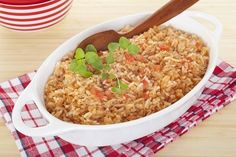 A serving bowl full of Spanish rice, a perfect accompaniment for chili. It's flavoured with onion, garlic, chicken stock, tomato and oregano.