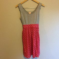 *3/$10*   Tank Dress This simple dress has a gray tank on the top and a bottom with a red geometric print that flows out. Ties in the back. Mossimo Supply Co Dresses