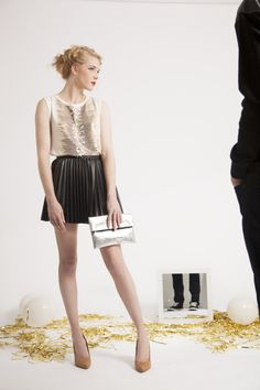 New Year's Eve inspired photo shoot. Black pleated leather skirt, nude beige pumps, and a sparkly top. #NYE | Photographer: Anthony Rogers Model: Nancy Waters