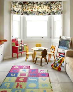 Bayswater Family Home Family Room multicoloured butterfly roman blinds, stone flooring
