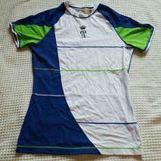 VS SPORT SHIRT VS WORKOUT SHIRT SIZE MEDIUM never worn NWT length of shirt is 24 can you go out with me shoulder to shoulder is 16 blue white and green is the colors of the shirt wording numbers and a crown are in Black number on back 14 is in white have additional questions or need additional pictures please ask I'll be happy to provide Victoria's Secret Tops Tees - Short Sleeve