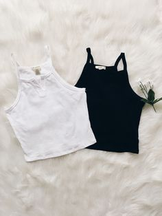 Spaghetti straps front slit crop top. A knit cami with a slight slit neckline and a cropped hem.