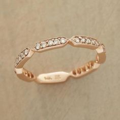 Sparkling diamonds in cartouches of 14kt rose gold ring your finger with brilliance and original, timeless style. Handcrafted. Whole and half sizes 5 to 8.