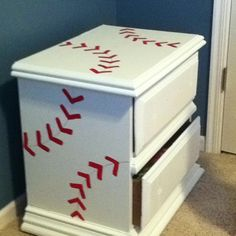 I took an old brown dresser and night stand and painted them with white paint with primer-3 coats! Took red paint and a thin brush to make the baseball stripes- no stencil. Then took a red paint pen to draw a thin red line for the seam.
