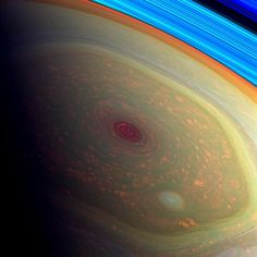 A false-color view of Saturn's storm, as seen through Cassini's wide-angle camera. The blue bands at the edge are Saturn's rings. Credit: NASA/JPL-Caltech/SSI