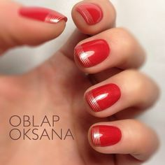 This features bright red nail polish that's ultra feminine. Striped silver French tips makes it even more appealing. Try this cutting edge look now!