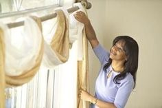 How to Wrap Curtains Around Curtain Rods | eHow