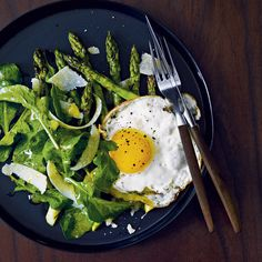 The East Room • London  Chef Mark Broadbent upgrades the standard lemony arugula salad by topping it with grilled asparagus, butter-fried eggs—d...