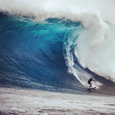 """Koa Rothman charging XXL size Jaws. """"This was definitely the biggest wave that I have ever paddled into and having this thing land on my head was not so fun..I popped up right next to a boat that had flipped on the wave before.."""" #QuikSurf"""