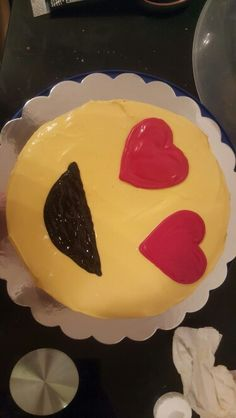 DIY EMOJI CAKE  Tools used was  Boxed cake mix  Homemade butter cream or store bought it's your cake do what you like!!  Red candy melts Heart stencil  & wiltons black sparkling gel
