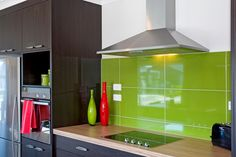Brightly coloured feature splashback in the kitchen.