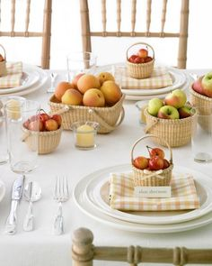 Wicker vessels brimming with fruit add a charming touch to a reception table.