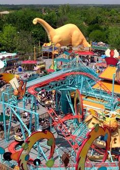 Hey, look! It's Dinoland USA at Animal Kingdom! Confession:this was my first ride of the trip, the bid blue thing, much scarier than it looks and if you have any neck or back problems watch it.....when it decides to change direction it is quick and hard about it