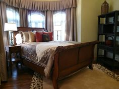 In this guest bedroom, notice the antique Chinese end tables on both sides of the bed. Also in the corner of the room is a Qing Dynasty bookshelf .