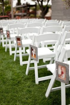 "Decorate your aisle with photos from the past, leading to more recent photos closest to the altar. It's a fun way to ""walk your journey"" on your wedding day!"