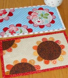 The Sunflower Patch mug rug pattern includes two very different designs.  Version 1 'Sunflowers' shown here.