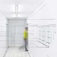 Swiss designers ZMIK  Wall line drawings of room interiors that only make sense from certain positions in the hallways.