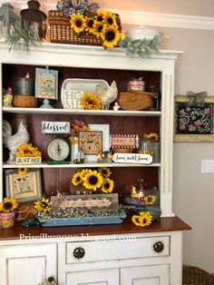 The hutch is all filled with sunflowers and bees .( and lots of chickens) :) I found this hutch on Craigslist last Octo. Sunflower Room, Sunflower Kitchen Decor, Diy Kitchen Decor, Farmhouse Kitchen Decor, Sunflower Decorations, Sunflower Season, Decorating Bookshelves, Hutch Decorating, Fall Decorating