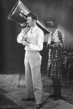 marypickfords:  Mary Pickford's powerful role as a producer is behind this humorous moment with director William Beaudine on the set of Little Annie Rooney (1925)