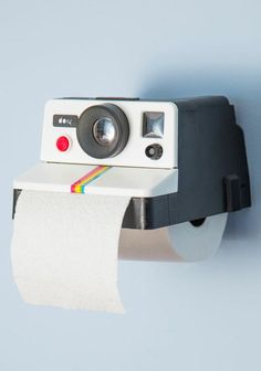 Polaroid toilet tissue holder - hilarious! #product_design