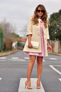 Extremely classy pink dress, tan pea coat, oversized sunglasses.