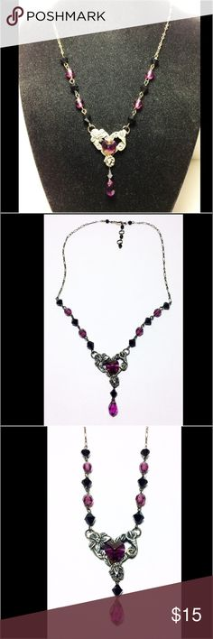 """Vintage  Pewter Necklace Purple Black Glass Beads Beautiful vintage style pewter necklace with purple and black glass beads.  Has a floral pendant with purple hear center.  Has a strong lobster clasp. In excellent like new condition. The necklace measures 18"""".  The pendant hangs down 1-1/2"""".  Please contact me if you have any questions. Jewelry Necklaces"""